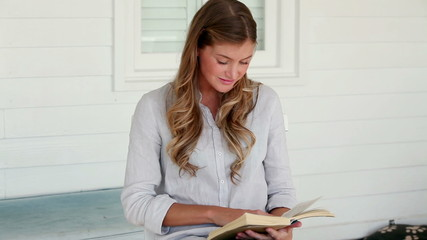 Woman beginning to read a book