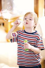Boy blowing bubbles, close-up