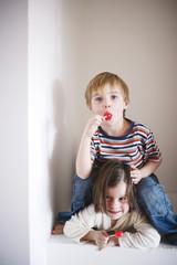 Children holding lollipops, portrait