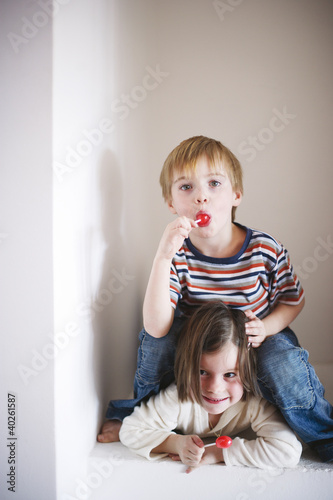 Children holding lollipops, portrait