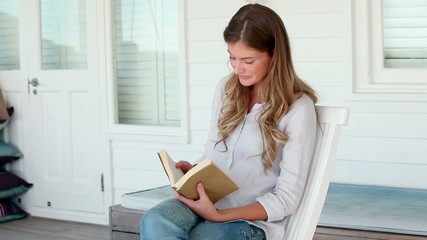 Woman happily reading a book