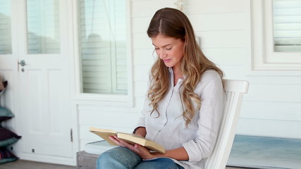 Woman peacefully reading a book