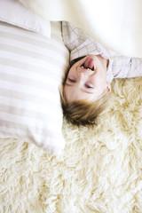 Boy lying on carpet, portrait
