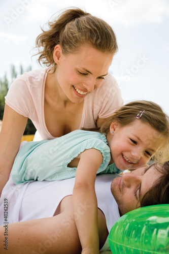 Mother with daughter lying on father