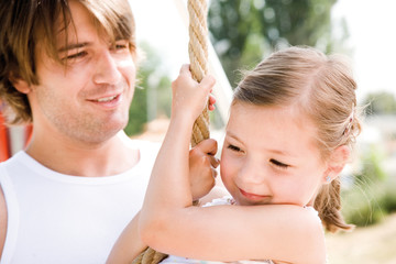Daughter with father, smiling