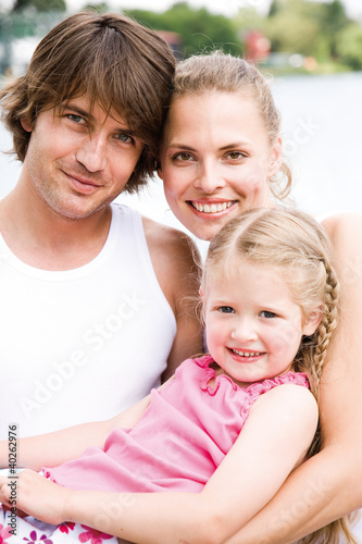 Daughter with parents, smiling, portrait