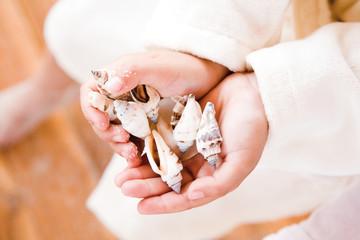 Girl holding shells, close-up