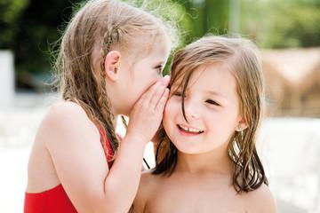 Sisters whispering