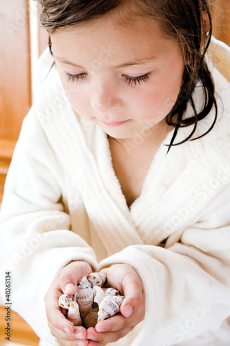 Girl holding shells, close-up
