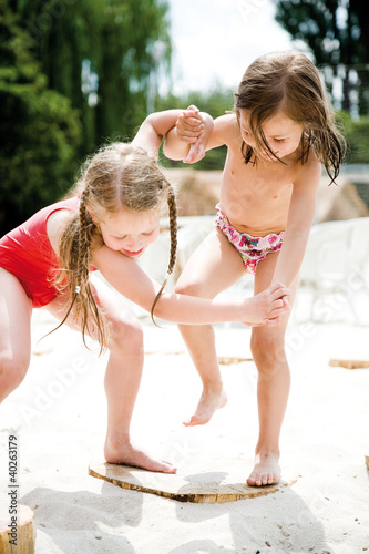 Girls playing on sand