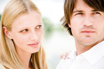 Young couple looking away, close-up