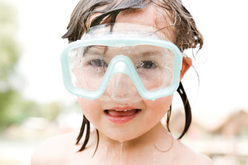 Girl wearing scuba mask, close-up, portrait