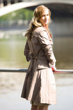 Businesswoman standing by river, portrait