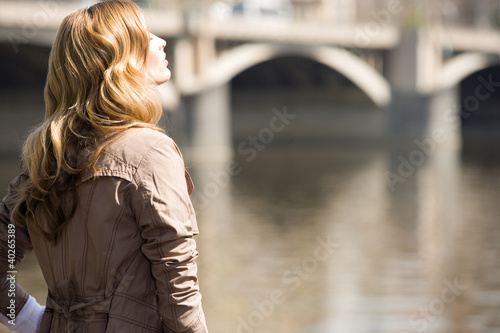 Businesswoman standing by river