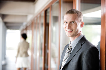 Businessman smiling, side view, portrait