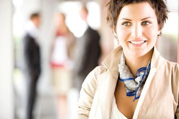 Businesswoman smiling, looking away