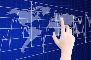 Hand pushing finance graph.