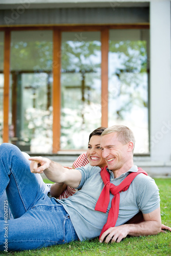 Young couple lying on grass, smiling