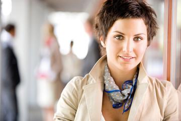 Businesswoman smiling, portrait