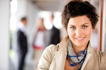 Businesswoman smiling, portrait