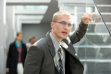 Businessman wearing glasses, portrait