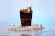 Splashes of cold cola drink