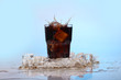 Splashes of cold cola drink