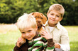 Boys playing with bulldog, portrait