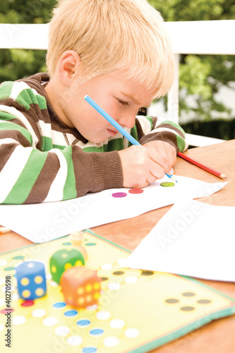 Boy using pencil
