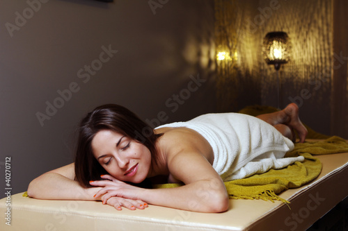 Young woman relaxing in spa salon