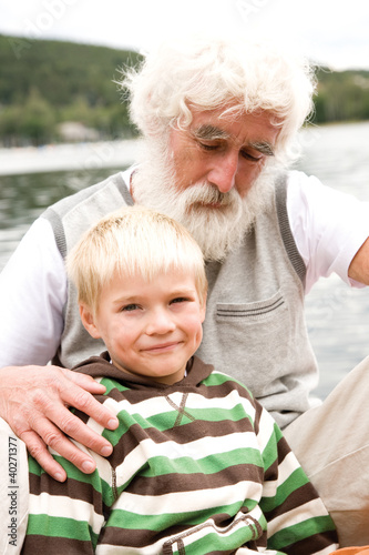 Grandfather sitting with grandson, portrait
