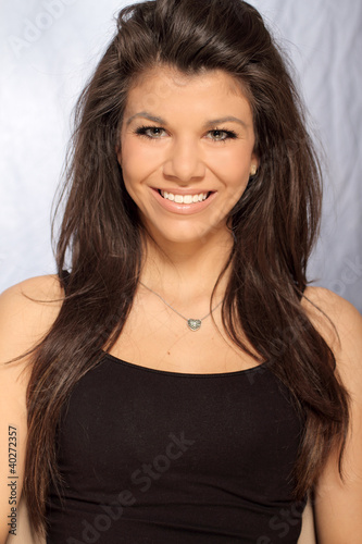 woman posing and smiling at camera