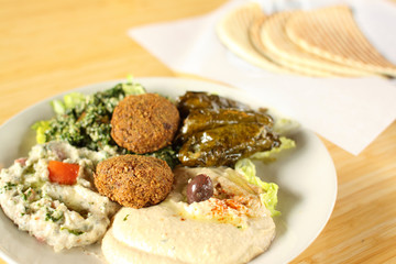 Falafel plate with hummus, baba ganoush, tabouli, and dolmas.
