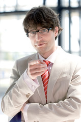 Businessman gesturing, portrait