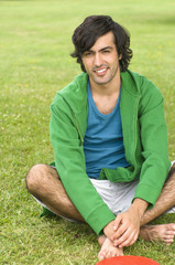Young man in green hooded shirt, smiling