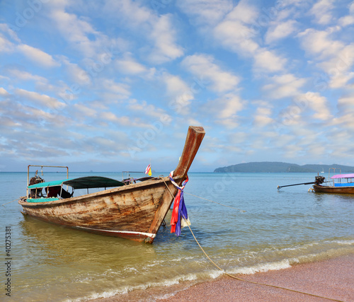 Beautifully native boat Longtail in beach sand