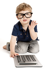 Cute boy counting with calculator.