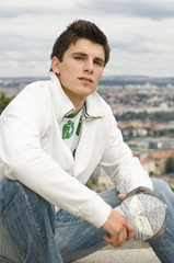 Young man in white jacket