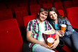 Young couple in cinema watching movie