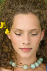 Young woman lying, eyes closed
