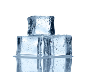 Melting ice cubes over white background with copy space