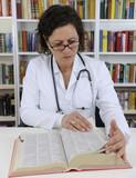 Doctor looking up information on medicine