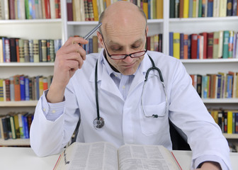 Doctor looking up information on medicine