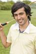 Young man holding badminton racquet, portrait