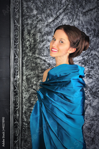 beautiful young brunette in blue vintage dress
