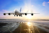 Fototapety Passenger airplane landing on runway in airport. Evening