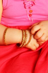 Baby hands, with golden bracelets