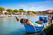 Leinwanddruck Bild - Beautiful fisherman boat in the city centre of Grado, Italy.