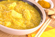 Chicken-mango curry with curry powder and ginger in back