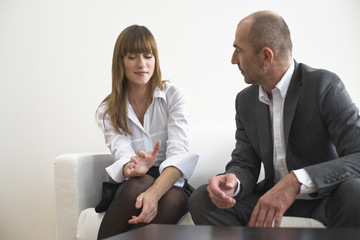 Businessman conversing with businesswoman